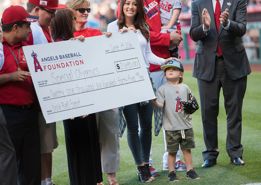 Aden Weaver helps his parents celebrate raising $21,645 for the Special Olympics Tuesday night at Angel Stadium.<br /> <br /> ///ADDITIONAL INFO:   <br /> <br /> angels.0615.kjs  ---  Photo by KEVIN SULLIVAN / Orange County Register  -- 6/14/16<br /> <br /> The Los Angeles Angels take on the Minnesota Twins Tuesday at Angel Stadium.