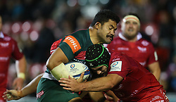 Leicester Tigers' Tatafu Polota-Nau is tackled by Scarlets' Tom Price during the Heineken European Champions Cup match at Welford Road, Leicester. PRESS ASSOCIATION Photo. Picture date: Friday October 19, 2018. See PA story RUGBYU Leicester. Photo credit should read: Mike Egerton/PA Wire. RESTRICTIONS: Editorial use only. No commercial use.