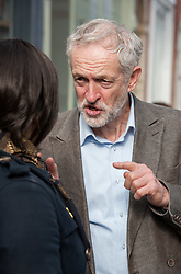 © Licensed to London News Pictures. 15/10/2015. Bristol, UK.  JEREMY CORBYN, leader of the Labour Party, visits shops in Picton Street, Montpelier, Bristol, following a rally for Labour Party members at the Trinity Centre in Bristol, to highlight and oppose the impact of the Government's changes to voter registration, expected to remove 1 million voters from the electoral roll by the end of the year. Photo credit : Simon Chapman/LNP