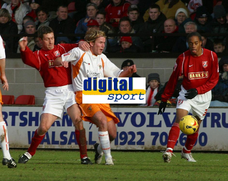 Photo: Dave Linney.<br />Walsall v Blackpool. Coca Cola League 1. 31/12/2005.<br />Simon Osborn(Walsall) battles for the ball with Carian Donnelly(Blackpool)
