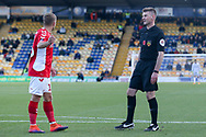 Ollie Yates Referee chats with Jamie Ward of Charlton Athletic (16) during the The FA Cup match between Mansfield Town and Charlton Athletic at the One Call Stadium, Mansfield, England on 11 November 2018.