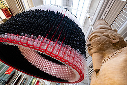 Event Horizon balloon sculpture,  beside Statue of Arensnuphis ,unveiled at National Museum of Scotland. American artist Jason Hackenwerth returns to Edinburgh with his biggest creation yet:
