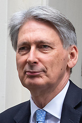 © Licensed to London News Pictures. 12/12/2018. London, UK. Chancellor of the Exchequer Philip Hammond leaves 11 Downing Street to attend Prime Minister's Questions in the Houses of Parliament. Tonight a vote of no confidence in British Prime Minister Theresa May's leadership will take place. Photo credit : Tom Nicholson/LNP