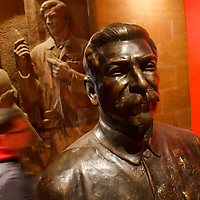 Visitor moves past a large Stalin statue on display at a free exhibition in Terror House Museum during Hungary's national holiday commemorating the revolution of 1956 in Budapest, Hungary on October 23, 2014. ATTILA VOLGYI