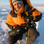 Daniel J. Cox pauses outside of Buggy One on the shores of Hudson Bay near Churchill, Manitoba.