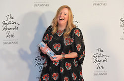 Sarah Burton collects the British Brand Award for Alexandrer McQueen in the press room during The Fashion Awards 2016 at the Royal Albert Hall, London.