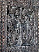 Carved wood pillars at Embekke Devale.`