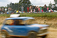 Spectators look on during the race meeting at Smallfield Raceway, Surrey, UK on the 10th of July 2011 (photo by Andrew Tobin/SLIK images)
