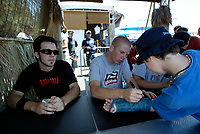 """Jul 01, 2003; Anaheim, California, USA; Moto X star athletes ROBERT DISTLER (L) & CHUCK CAROTHERS (R) sign autographs after their show at the opening of Disney's California Adventure """"X Games Experience"""".  Disney park has built two X-Arena's specifically for this 41 day event highlighting extreme sports for the launch of the 2003 ESPN X Games.<br />Mandatory Credit: Photo by Shelly Castellano/Icon SMI<br />(©) Copyright 2003 by Shelly Castellano"""