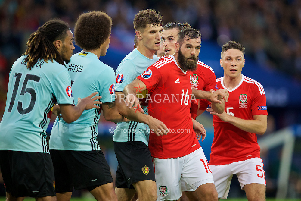 LILLE, FRANCE - Friday, July 1, 2016: Wales' Joe Ledley and James Chester in action against Belgium during the UEFA Euro 2016 Championship Quarter-Final match at the Stade Pierre Mauroy. (Pic by David Rawcliffe/Propaganda)