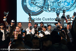 Group photo of all the winners with their trophies at the AMD World Championship of Custom Bike Building Award Ceremony on the stage in the custom dedicated Hall 10 at the Intermot Motorcycle Trade Fair. Cologne, Germany. Sunday October 9, 2016. Photography ©2016 Michael Lichter.