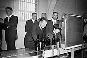26/09/1962<br /> 09/26/1962<br /> 26 September 1962<br /> Opening of Earl Bottlers Ltd. at South Earl Street, Dublin. Minister for Justice Charles Haughey opened the new premises that produced Sandyman port. Mr Haughey inspecting machinery  on the production line. On left is Nigel Beamish and on right is W. Campbell, Directors.