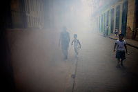 children in smokey street in havana, cuba