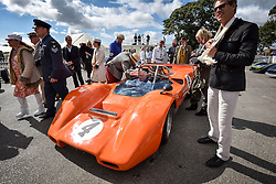 © licensed to London News Pictures. 12/09/2015<br /> Goodwood Revival Weekend, Goodwood, West Sussex. UK.<br /> The Goodwood Revival is the world's largest historic motor racing event. Competitors and enthusiasts dress in period fashions recreating the glorious days of the race circuit.<br /> Pictured A classic McLaren in the paddock.<br /> <br /> Photo credit : Ian Whittaker/LNP