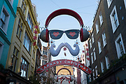 Christmas decorations along Carnaby Street, London, UK. Carnaby Street is a pedestrianised shopping area and is home to numerous fashion and lifestyle retailers, including a large number of independent fashion boutiques.