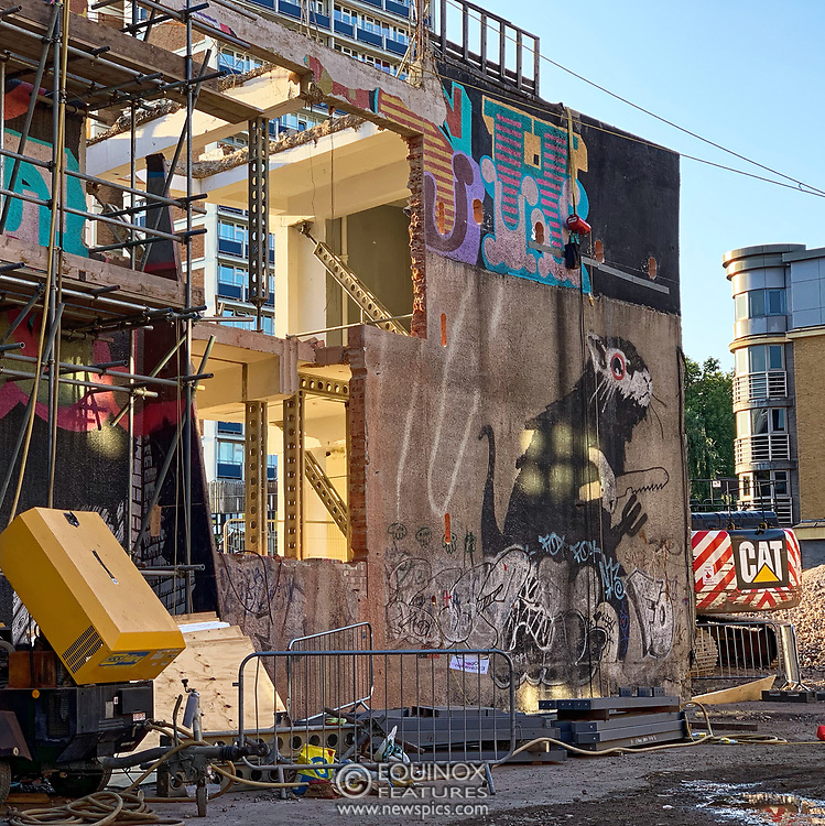 London, United Kingdom - 7 September 2019<br /> EXCLUSIVE SET - Aerial construction specialists and demolition experts use a huge crane to carefully lift intact, a twenty five ton, two-story wall, to preserve a famous Banksy rat image which has been covered up for years. Teams from specialist companies have spent over six weeks cutting around the artwork and fitting custom made eight ton steel supports to enable them to save the historic piece of art. Work has started on the construction of a new twenty seven floor art'otel hotel on the site of the old Foundry building in Shoreditch, east London, and a condition of the planning permission was to preserve the historical Banksy graffiti. A second section of the painting, an image of a TV being thrown through a broken window has already been cut out and moved separately. After the hotel construction is complete the two parts of the Banksy painting will be displayed on the hotel. Our pictures show the stages of work to protect the image, culminating in the lifting of the three story wall by crane. Video footage also available.<br /> (photo by: EQUINOXFEATURES.COM)<br /> Picture Data:<br /> Photographer: Equinox Features<br /> Copyright: ©2019 Equinox Licensing Ltd. +443700 780000<br /> Contact: Equinox Features<br /> Date Taken: 20190907<br /> Time Taken: 181447<br /> www.newspics.com