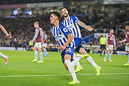 Shane Duffy (Capt) (Brighton) in the background smiling as Haydon Roberts (Brighton) celebrates his goal during the EFL Cup match between Brighton and Hove Albion and Aston Villa at the American Express Community Stadium, Brighton and Hove, England on 25 September 2019.