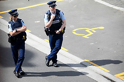 March 17, 2019 - Christchurch, New Zealand - Police officers stand guard outside the Christchurch District Court where the suspected shooter appeared in Christchurch on March 16, 2019. At least 49 people have died in the Christchurch mosque shooting, the worst terror attack in New Zealand history. The national security threat level has been increased from low to high for the first time in New Zealand's history after this attack. (Credit Image: © Sanka Vidanagama/NurPhoto via ZUMA Press)