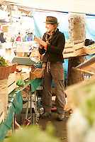 """in the Organic weekly market called """"Raspail"""" in the 6th arrondissement of Paris..Camille, a graphic artist who works on Sunday selling organic vegetables in the market. photo Owen Franken."""