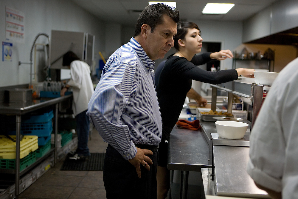 Agaveros Restaurant owner Rafael Garcia supervises production in the kitchen on Saturday night, Oct. 11, 2009..