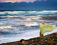 Blustery weather did not deter this woman from enjoying a day at the beach in southern California.