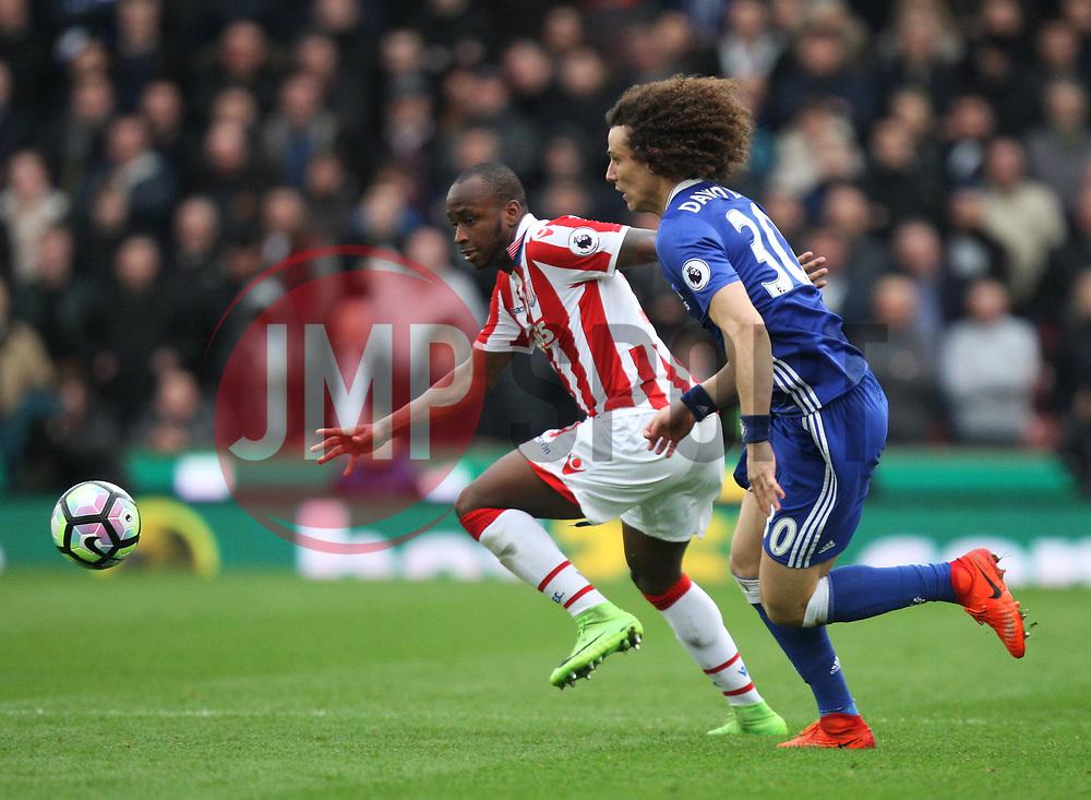 Saido Berahino of Stoke City (L) and David Luiz of Chelsea in action - Mandatory by-line: Jack Phillips/JMP - 18/03/2017 - FOOTBALL - Bet365 Stadium - Stoke-on-Trent, England - Stoke City v Chelsea - Premier League
