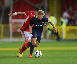 Southampton's Lloyd Isgrove battles for the ball with Swindon Town's Massimo Luongo - Photo mandatory by-line: Joe Meredith/JMP - Mobile: 07966 386802 21/07/2014 - SPORT - FOOTBALL - Swindon - County Ground - Swindon Town v Southampton
