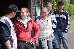 Group of teenagers waiting for a bus,