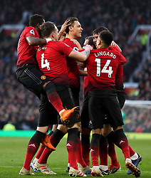 Manchester United's Nemanja Matic celebrates scoring his side's first goal of the game with his team-mates during the Premier League match at Old Trafford, Manchester.