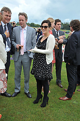 SAM COOPER and LILY ALLEN at the 2011 Veuve Clicquot Gold Cup Final at Cowdray Park, Midhurst, West Sussex on 17th July 2011.