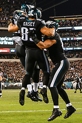 Philadelphia Eagles tight end James Casey #85 is congratulated by the other tight ends (Brent Celek #87 and Zach Ertz #86) after Casey scored a touchdown during the NFL game between the New York Giants and the Philadelphia Eagles at Lincoln Financial Field in Philadelphia on Sunday October 12th 2014. The Eagles won 27-0. (Brian Garfinkel/Philadelphia Eagles)