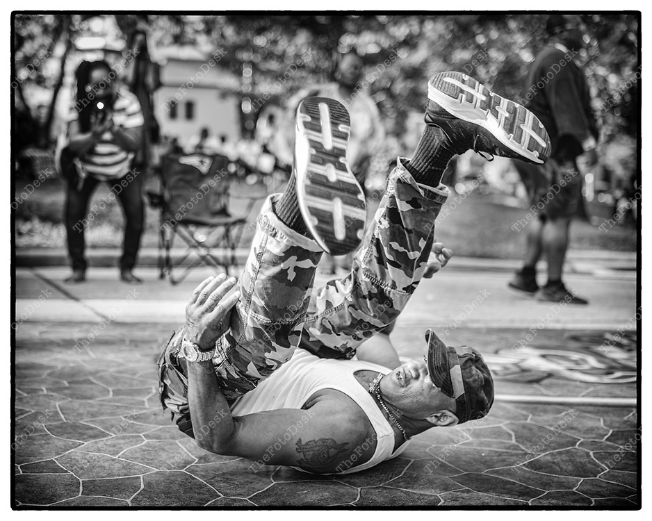 """JERSEY CITY, NEW JERSEY:  Mark Stanberry, William 57, of. Jersey City, NJ break dances during the After Work Mondays SoululHouse Music, Club Classics by DJ Ricky Clark at Arlington Park, in Jersey City, NJ. Stanberry, a veteran, discovered House when he came home from the military.  And discovered the Zanzabar and the house music. """"At first it didn't catch on but it has become my drug of choice for the last 20-30 years"""" (Brian B Price/TheFotodesk)."""