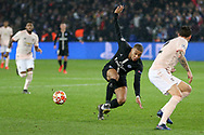 Kylian Mbappe of Paris Saint-Germain shoots at goal past Manchester United Defender Victor Lindelof during the Champions League Round of 16 2nd leg match between Paris Saint-Germain and Manchester United at Parc des Princes, Paris, France on 6 March 2019.