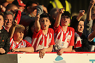 young Accrington Stanley fans chanting during the 1st half. Skybet football league two play off semi final, 1st leg match, AFC Wimbledon v Accrington Stanley at the Cherry Red Records Stadium in Kingston upon Thames, Surrey on Saturday 14th May 2016.<br /> pic by John Patrick Fletcher, Andrew Orchard sports photography.