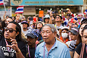 """15 JANUARY 2014 - BANGKOK, THAILAND: Anti-government protestors wait to see Suthep Thaugsuban during a protest march in Bangkok. Tens of thousands of Thai anti-government protestors continued to block the streets of Bangkok Wednesday to shut down the Thai capitol. The protest, """"Shutdown Bangkok,"""" is expected to last at least a week. Shutdown Bangkok is organized by People's Democratic Reform Committee (PRDC). It's a continuation of protests that started in early November. There have been shootings almost every night at different protests sites around Bangkok. The malls in Bangkok are still open but many other businesses are closed and mass transit is swamped with both protestors and people who had to use mass transit because the roads were blocked.    PHOTO BY JACK KURTZ"""
