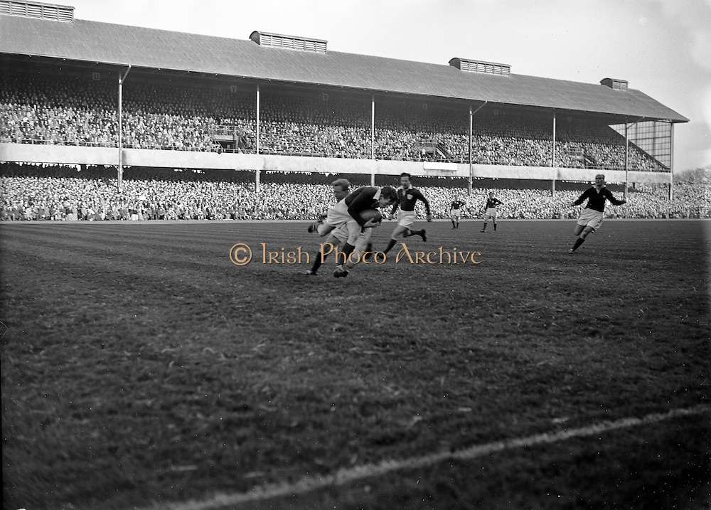 Irish Rugby Football Union, Ireland v Scotland, Five Nations, Landsdowne Road, Dublin, Ireland, Saturday 25th February, 1956,.25.2.1956, 2.25.1956,..Referee- H B Elliott, Rugby Football Union,..Score- Ireland 14 - 10 Scotland, ..Irish Team, ..P J Berkery, Wearing number 15 Irish jersey, Full back, Landsdowne Rugby Football Club, Dublin, Ireland,..W J Hewitt, Wearing number 14 Irish jersey, Right Wing, Instonians Rugby Football Club, Belfast, Northern Ireland,..N J Henderson, Wearing number 13 Irish jersey, Captain of the Irish team, Right centre, N.I.F.C, Rugby Football Club, Belfast, Northern Ireland,..A J O'Reilly, Wearing number 12 Irish jersey, Left Centre, Old Belvedere Rugby Football Club, Dublin, Ireland,  ..A C Pedlow, Wearing number 11 Irish jersey, Left Wing, Queens University Rugby Football Club, Belfast, Northern Ireland,..J W Kyle, Wearing number 10 Irish jersey, Outside Half, N.I.F.C, Rugby Football Club, Belfast, Northern Ireland,..J A O'Meara, Wearing number 9 Irish jersey, Scrum Half, Dolphin Rugby Football Club, Cork, Ireland, ..W B Fagan, Wearing number 1 Irish jersey, Forward, Wanderers Rugby Football Club, Dublin, Ireland, and, Moseley Rugby Football Club, Birmingham, England, ..R Roe, Wearing number 2 Irish jersey, Forward, London Irish Rugby Football Club, Surrey, England, and, Landsdowne Rugby Football Club, Dublin, Ireland,..B G Wood, Wearing number 3 Irish jersey, Forward, Garryowen Rugby Football Club, Limerick, Ireland, ..B N Guerin, Wearing  Number 4 Irish jersey, Forward, Bective Rangers Rugby Football Club, Dublin, Ireland, and, Galwegians Rugby Football Club, Galway, Ireland, ..L M Lynch, Wearing number 5 Irish jersey, Forward, Landsdowne Rugby Football Club, Dublin, Ireland, ..C T J Lydon, Wearing  Number 6 Irish jersey, Forward, Galwegians Rugby Football Club, Galway, Ireland, and, Monkstown Rugby Football Club, Dublin, Ireland, ..J R Kavanagh, Wearing number 7 Irish jersey, Forward, Wanderers Rugby Football Club, Dublin, Ireland, .
