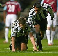 Photo: Andrew Unwin.<br /> Newcastle United v West Ham United. The Barclays Premiership. 20/01/2007.<br /> Newcastle's Scott Parker (L) is helped to his feet by Nolberto Solano (R).