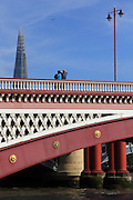 People stop to photograph the Shard from Blackfriars Bridge