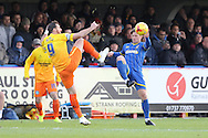 Dannie Bulman of AFC Wimbledon and Paul Hayes (Captain) of Wycombe Wanderers tussle during the Sky Bet League 2 match between AFC Wimbledon and Wycombe Wanderers at the Cherry Red Records Stadium, Kingston, England on 21 November 2015. Photo by Stuart Butcher.