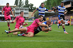 Jonathan Joseph of Bath Rugby reaches for the try-line - Photo mandatory by-line: Patrick Khachfe/JMP - Mobile: 07966 386802 13/09/2014 - SPORT - RUGBY UNION - Bath - The Recreation Ground - Bath Rugby v London Welsh - Aviva Premiership
