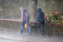 © Licensed to London News Pictures. 06/06/2020. London, UK. Members of the public are caught in a heavy downpour in London. Photo credit: Dinendra Haria/LNP