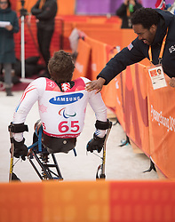 March 14, 2018 - Pyeongchang, South Korea - Tyler Walker of the US is congratulated by Cory Marquis Thomas after winning the silver medal in the Giant Slalom competition (Sitting) Wednesday, March 14, 2018 at the Jeongson Alpine Center at the Pyeongchang Winter Paralympic Games. Photo by Mark Reis (Credit Image: © Mark Reis via ZUMA Wire)