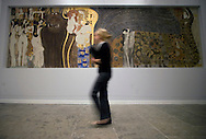 A visitor walking past a section of The Beethoven Frieze (1901-2), part of Gustav Klimt: Painting, Design and Modern Life in Vienna 1900 at the Tate Liverpool which opens on 30th May, 2008. The gallery is hosting the first-ever UK exhibition by Austrian artist Klimt (1862-1918) as part of Liverpool's reign as 2008 European Capital of Culture. The show includes a full-scale reconstruction of the The Beethoven Frieze in addition to numerous paintings, drawings and furniture designs and runs until 31st August, 2008.