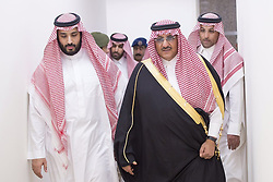 File photo - Saudi Arabia's Deputy Crown Prince and interior minister Prince Mohammad bin Nayef (R) and Defense Minister Prince Mohammed bin Salman bin Abdelaziz Al Saud (L) seen leading the operation Decisive Stormair campaign, launched against Houthi militants in Yemen, from the main command centre in Riyadh, Saudi Arabia, on March 26, 2015. Saudi Arabia's king has appointed his son Mohammed bin Salman as crown prince - replacing his nephew, Mohammed bin Nayef, as first in line to the throne. Prince Mohammed bin Nayef, 57, has been removed from his role as head of domestic security, state media say. Photo by Balkis Press/ABACA.
