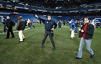 Photo:Jose Luis Cuesta/Back Page Images<br />Real Madrid v Real Sociedad, La Liga, Santiago Bernabeu Stadium 12/12/04<br />Fans are evacuated before the end of the game while this security guard appears to perform a dance on the pitch