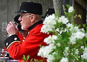 © Licensed to London News Pictures. 20/05/2013. London, UK A Chelsea pensioner enjoys a drink. Press day at Chelsea Flower Show 2013. The centenary edition of the show attracts large number of visitors and is already sold out before opening day. Photo credit : Stephen Simpson/LNP