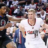 25 April 2016: Portland Trail Blazers center Mason Plumlee (24) drives past Los Angeles Clippers center DeAndre Jordan (6) during the Portland Trail Blazers 98-84 victory over the Los Angeles Clippers, during Game Four of the Western Conference Quarterfinals of the NBA Playoffs at the Moda Center, Portland, Oregon, USA.