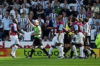 Photo: Andrew Unwin, Digitalsport<br /> Newcastle United v West Ham United. The Barclays Premiership. 20/08/2005.<br /> The referee, Dermot Gallagher (C), shows the red card to West Ham's Paul Konchesky (not shown) for his professional foul on Newcastle's Jermaine Jenas.<br /> Norway only