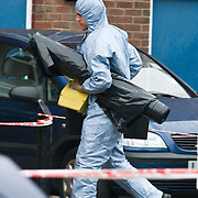 LONDON - JUNE 02: Police and forensic officers gather outside a block of flats where a 15-year-old girl was stabbed to death, in Lambeth on June 2, 2008 in London, England. According to reports the teenager was found with multiple stab wounds in a lift within the block. A man has been arrested.