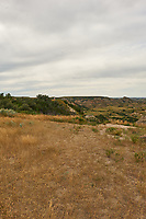 Painted Canyon Overlook Panorama. Theodore Roosevelt National Park. Image 1 of 6 taken with a Nikon D3x camera and 24 mm f/1.4 lens (ISO 100, 24 mm, f/16, 1/50 sec). Raw image processed with Capture One Pro and composite generated using AutoPano Giga Pro.